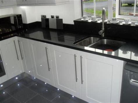 black gloss kitchen floor tiles kitchen fitters in cirencester howdens kitchen units 7874