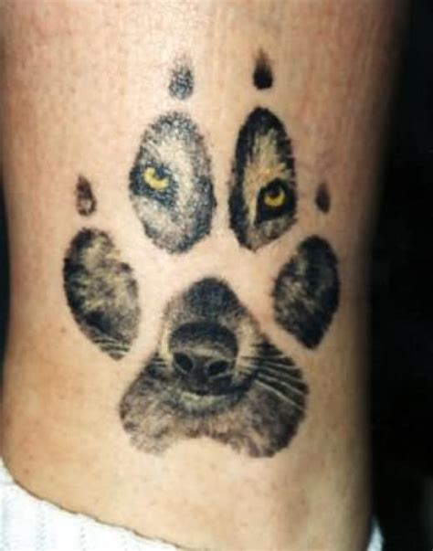 cool wolf paw face tattoo