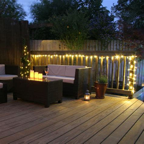 how to hang string lights on fence stylish wooden deck with wicker furniture for decorative