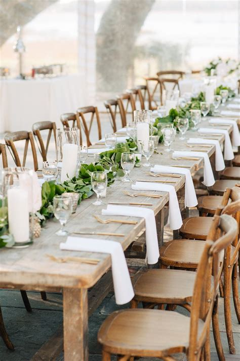 garland runner and candles on farm tables Farm table
