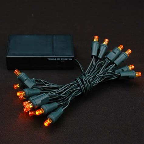 amber 20 light battery operated christmas lights on green