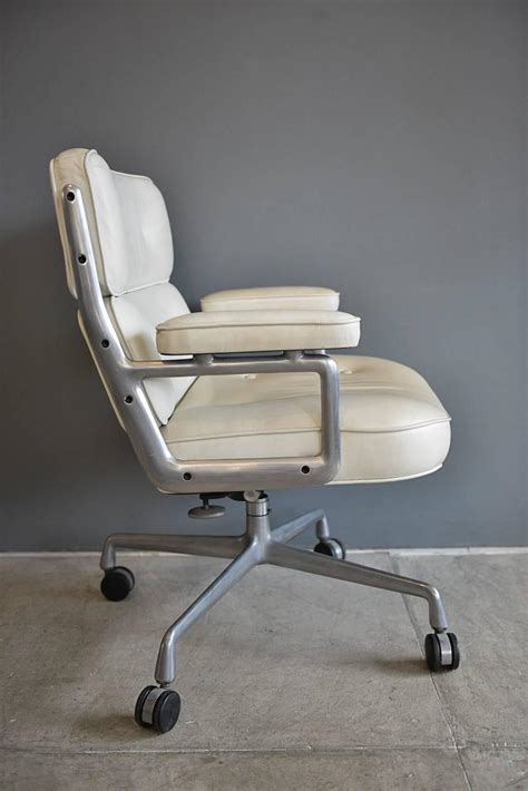 pair of charles eames time white leather chairs for