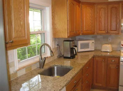 Marble Countertops With Honey Oak Cabinets