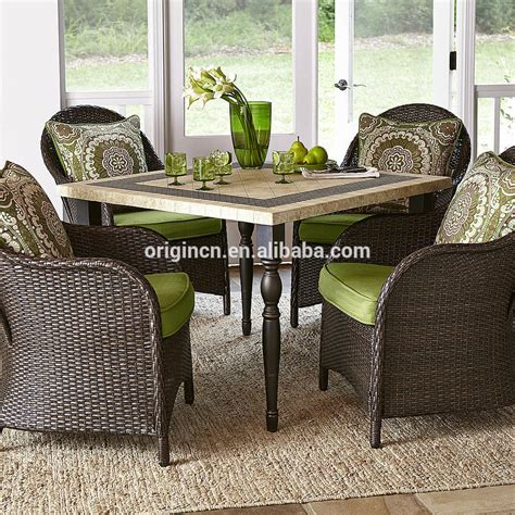granite top square table with 4 rattan dining chairs