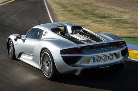 speed chions porsche 918 spyder the rear engined 918 spyder has a top speed of 215mph