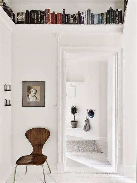 ceiling shelves  store  books   small home