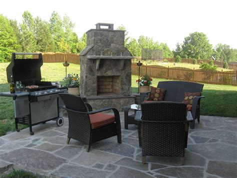 outdoor patio ideas with fireplace stone patio s add great aesthetic appeal to outdoor living spaces in charlotte archadeck of