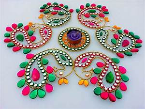 10 peacock kundan rangoli design Image