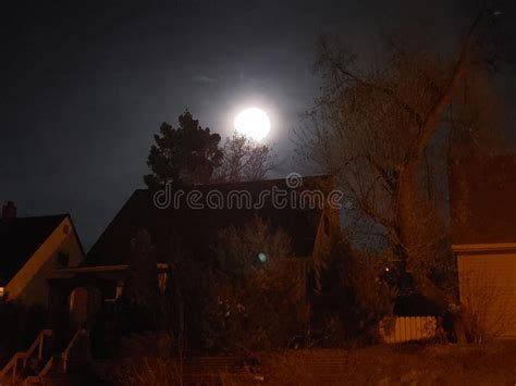 glowing moon   black night sky   beginning