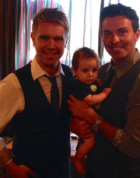 Neil Byrne And Ryan Kelly Ryan Holding A Babycute