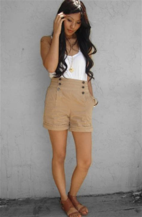 Picture Of Look with high waisted beige shorts and flat ...
