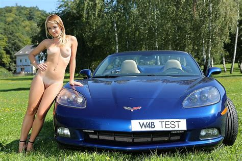Petite blonde Malinda nude next to a fast and expensive ...