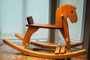 wooden rocking horses  handmade  belmont retiree