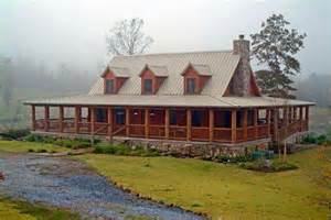 log homes with wrap around porches this is exactly what i want only on a smaller scale the wrap around porch log cabin