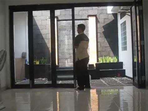 pintu lipat taman aluminium kaca penyekat ruang taman