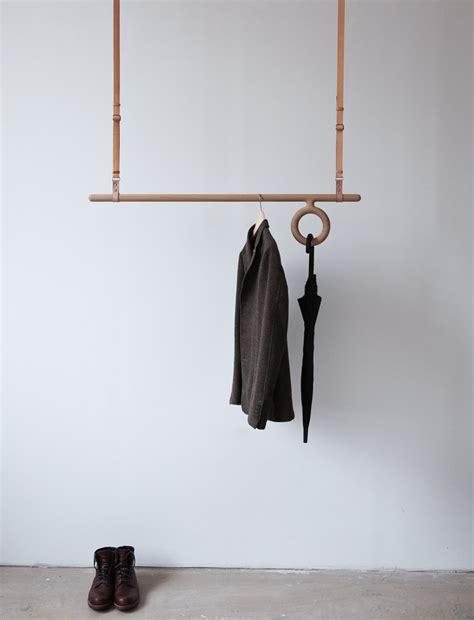 hanging coat rack florian saul designs a wood and leather hanging coat rack