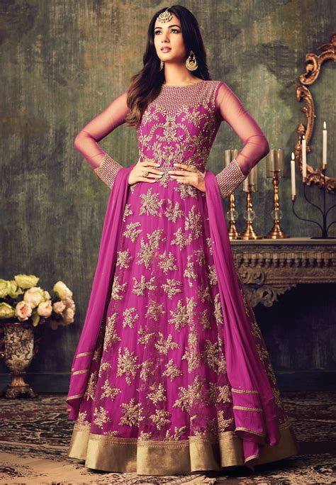 sonal chauhan pink net party wear pant suit