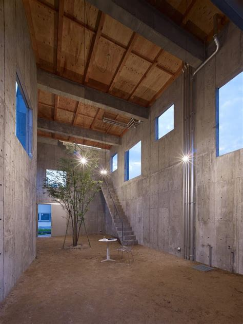 industrial chic concrete house interior courtyard