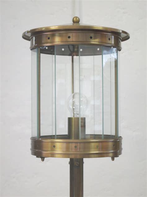 outdoor pedestal light  brass terra lumi