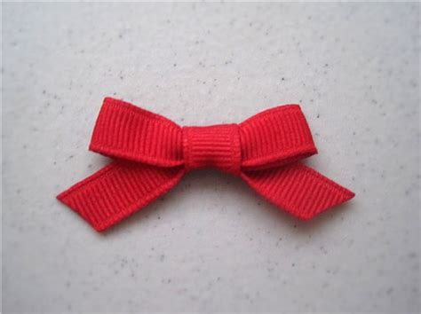 how to make a simple bow diy little fabric bow easy to make and or embellish could use as a hair bow if you glue to an