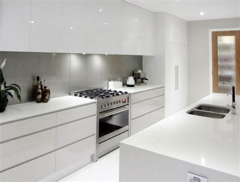 White cupboards, no handles, light grey splashback, all in
