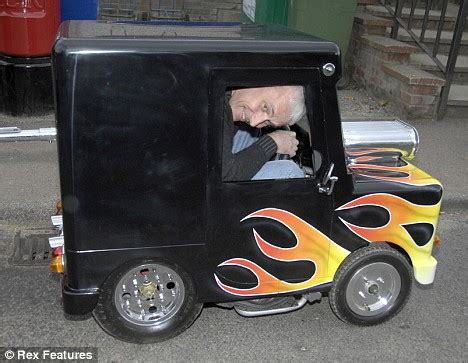 Man turns Postman Pat ride into world's smallest car ...