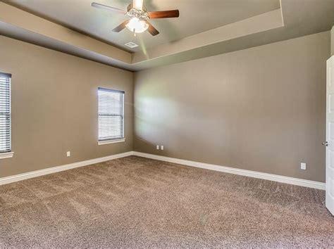 master bedroom designed  earth tones tan carpeting