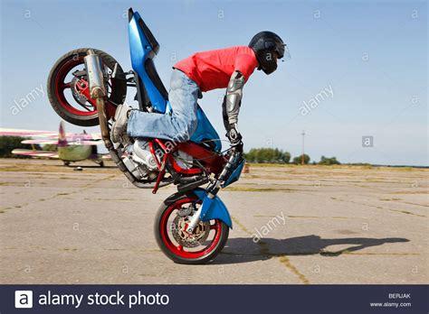 Stunt Bike Rider Making Stoppie Stock Photo