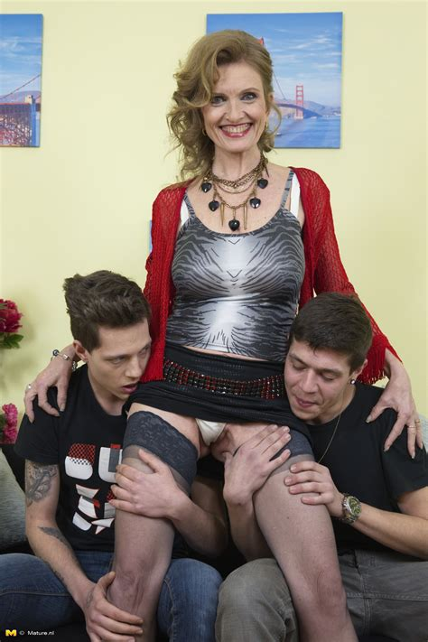 Two naughty boys doing a horny mature slut