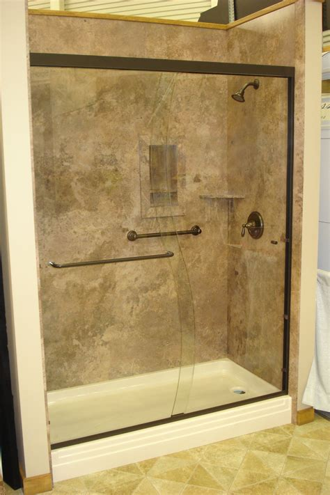 mocha travertine  oil rubbed bronze shower door oasis shower pan recessed shampoo niche