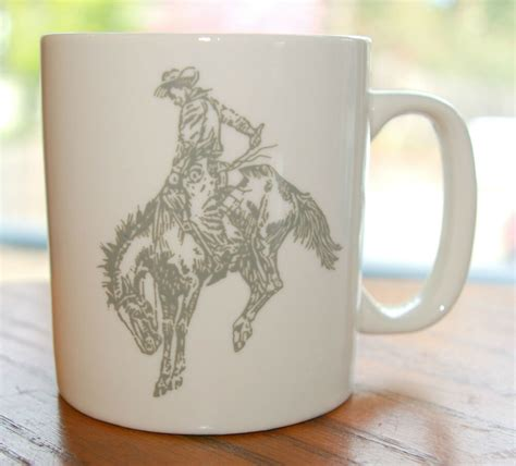 Sip from one of our many cowboy coffee mugs, travel mugs and tea cups offered on zazzle. Cowboy Western Coffee Mug Bucking Horse Horseback Rodeo Grey Hat Saddle Spurs   eBay