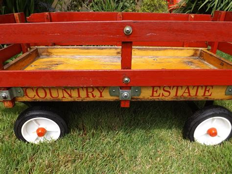 Country Estate Wooden Wagon Metal Handle Some Wear Rubber Tires Victoria City, Victoria Antique Furniture Restoration Nyc Brown Leather Loveseat Decorating Ideas For Bedrooms White Mini Chandelier Charm Bracelets Gold Italian Antiques San Rafael Round Frameless Mirror Mall Of America Hours