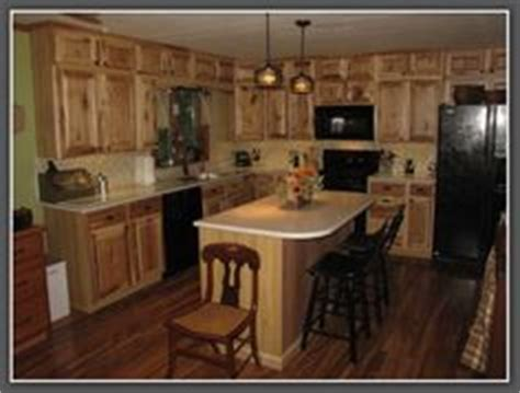 honey spice hickory cupboards  orange paint color
