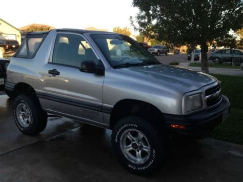 find   chevrolet tracker base sport utility  door