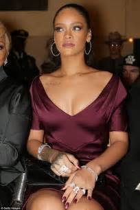 coordinate picture the normally risque rihanna looks demure in a sophisticated maroon dress at zac posen fashion