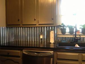 Corrugated metal backsplash dream home pinterest for Kitchen cabinets lowes with sheet metal wall art