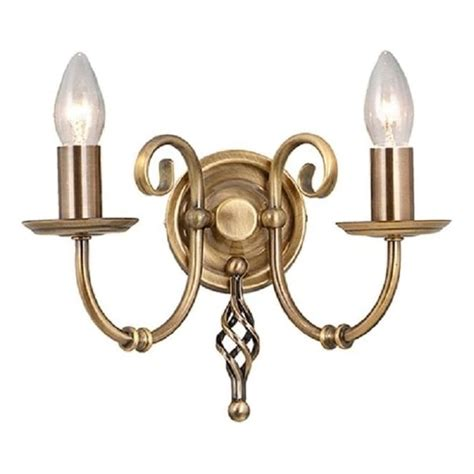 traditional candle style wall light in antique brass with