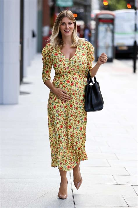 ashley james shows off her baby bump while out wearing a ...
