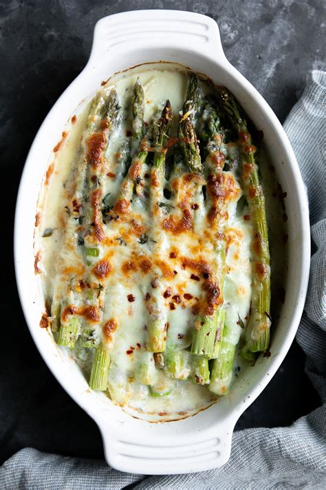 cheesy baked asparagus gratin recipe  forked spoon