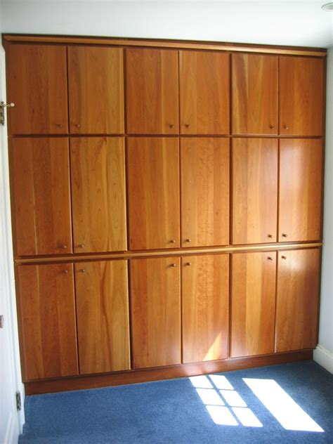 made built in closet wall with solid cherry doors by