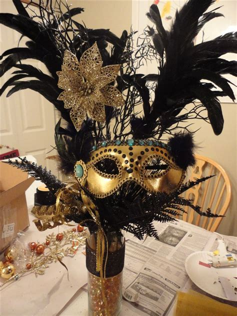 mask table decorations centerpiece i made for kailys masquerade