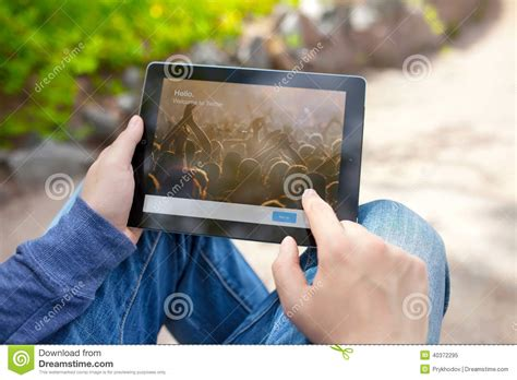 Man Holding Ipad With Twitter On The Screen Editorial
