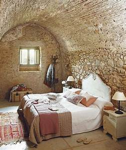 natural rock wall for rustic bedroom ideas with simple bed With interior rock wall design ideas