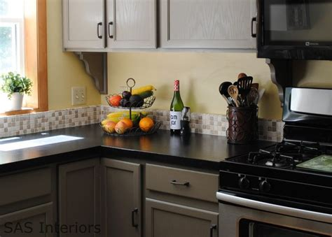 grey kitchen cabinets with black countertops this kitchen gray cabinets black countertops 8359