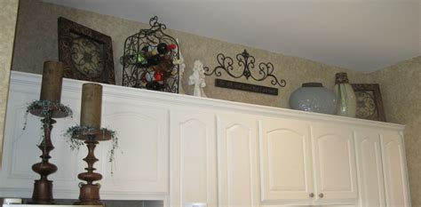 top of kitchen cabinet ideas what to decorate the top of kitchen cabinets with home
