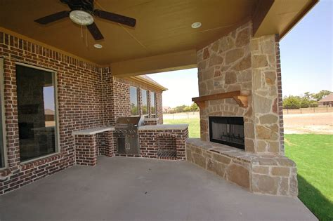 outdoor patio with built in grilling station and cozy