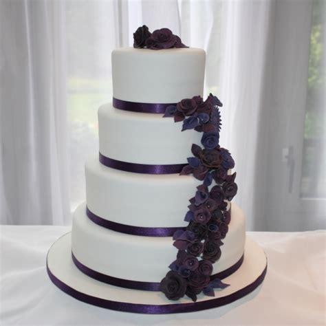 tier purple flowers wedding cake