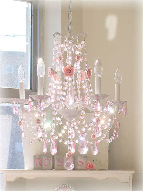 chandelier with pink roses and pink prisms the