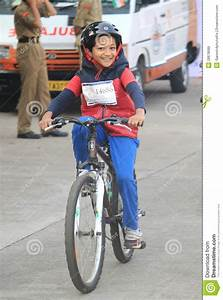 Kid Riding The Bicycle With Enthusiasm In The Republic Day ...