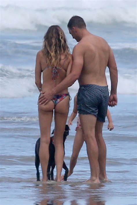 bikini clad gisele bundchen shows  bigger booty